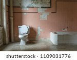 Pink Tile And Toilet In An...