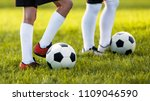 two young football players... | Shutterstock . vector #1109046590