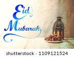 eid mubarak with date palm...   Shutterstock . vector #1109121524