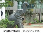 an elephant statue just soaked... | Shutterstock . vector #1109142446