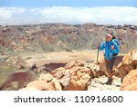 Woman hiking on volcano Teide, Tenerife. Hiker near summit of Teide during hike on Tenerife, Canary Islands, Spain. - stock photo