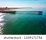 Small photo of Aerial photo of a very long pier with houses and cars in San Diego California