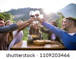 group of friends at restaurant... | Shutterstock . vector #1109203466