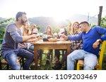 group of friends at restaurant... | Shutterstock . vector #1109203469