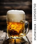 beer in mug on wooden table and ... | Shutterstock . vector #1109203733
