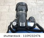 dslr camera holding of the... | Shutterstock . vector #1109232476