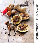 Small photo of Summer wild mushrooms mini tartelettes with savory short - crust pastry.