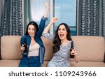 two women watch football on tv... | Shutterstock . vector #1109243966