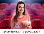 charming girl watching movie... | Shutterstock . vector #1109305214