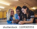 smiling young female friends... | Shutterstock . vector #1109305553