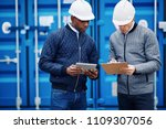 two engineers standing together ... | Shutterstock . vector #1109307056