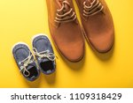 father and son shoes on yellow... | Shutterstock . vector #1109318429