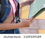 tourist holding the map. | Shutterstock . vector #1109339189