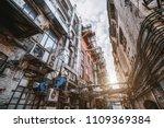 narrow atmospheric backstreet... | Shutterstock . vector #1109369384