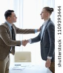 Small photo of welcoming handshake for a new employee. work recruitment. business career start. you are hired. good job.