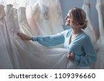 attractive bride choosing a... | Shutterstock . vector #1109396660