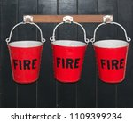 Small photo of Fire Buckets hanging on a wall