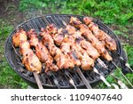 grilled meat on skewers.... | Shutterstock . vector #1109407640