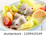 Stock photo marinated herring with vegetables 1109415149