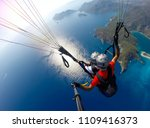 paragliding in the sky.... | Shutterstock . vector #1109416373