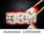 chopsticks holding sushi roll... | Shutterstock . vector #1109416658