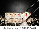 chopsticks holding sushi roll... | Shutterstock . vector #1109416670