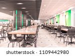 Stock photo modern interior of cafeteria or canteen with chairs and tables eating room in selective focus 1109442980