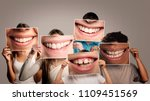 group of happy people holding a ... | Shutterstock . vector #1109451569