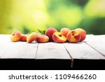 a group of ripe peaches on... | Shutterstock . vector #1109466260