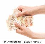 hands holding turkish lira...   Shutterstock . vector #1109478413