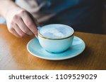 man holding blue matcha tea... | Shutterstock . vector #1109529029