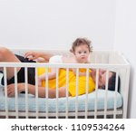 young father with his 7 month... | Shutterstock . vector #1109534264