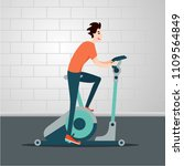 stationary bicycle. young man... | Shutterstock .eps vector #1109564849