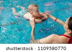 baby with mom learns to swim in ... | Shutterstock . vector #1109580770