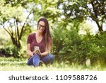 smiling young woman sitting on...   Shutterstock . vector #1109588726