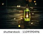 retro kerosene lamp with... | Shutterstock . vector #1109590496