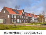 modern row houses with solar... | Shutterstock . vector #1109607626