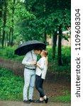attractive couple under an...   Shutterstock . vector #1109608304