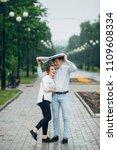 attractive couple in the rain...   Shutterstock . vector #1109608334