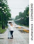 attractive couple in the rain...   Shutterstock . vector #1109608340
