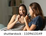 two friends enjoying eating... | Shutterstock . vector #1109613149