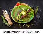 grilled meat dish with herbs in ... | Shutterstock . vector #1109613536