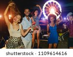 happy friends celebrating at... | Shutterstock . vector #1109614616