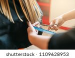 hairdresser with scissors in... | Shutterstock . vector #1109628953