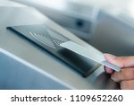 hand holding blue card to... | Shutterstock . vector #1109652260