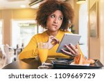 young afro woman having a...   Shutterstock . vector #1109669729