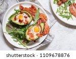 avocado egg boats with bacon.... | Shutterstock . vector #1109678876