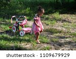 little girl and her tricycle... | Shutterstock . vector #1109679929