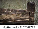 wooden boat with rope sitting... | Shutterstock . vector #1109687729