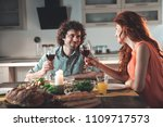 cheers. happy loving couple is... | Shutterstock . vector #1109717573